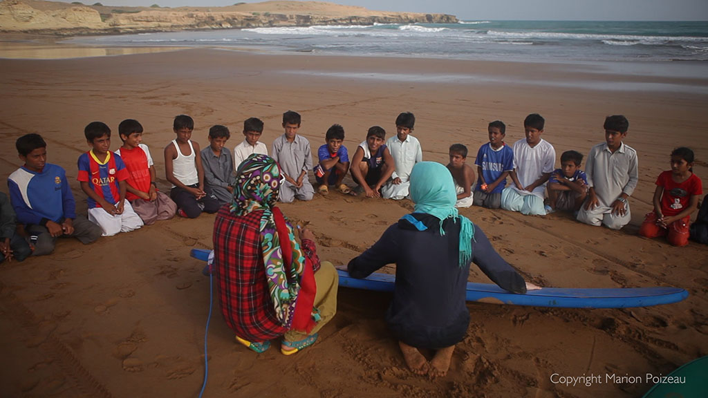 Teaching children to surf in Iran